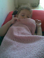 """This is my two year old daughter, Amira, sleeping. I want to make her life better, and for her to have a good education in the future. But the siege on Gaza is having a very bad impact on our lives, our economic situation, and on my daughter's life. We are very poor – we cannot afford any furniture in our home, because it's so expensive. We don't even have a bed – just this small bed for my daughter – we sleep on the floor"""