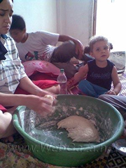 """This is me making bread, with my daughter and my sister's son. I can't afford to buy bread, so I am always making it at home and it takes a long time. It's also exhausting because I work full-time. I have to find time to work, clean my house, make bread, take care of my daughter…"""