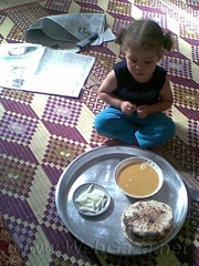 """This is our lunch – lentil soup, onions and bread. I try to make a variety of dishes but the ingredients are always the same – lentils. It's all we can afford"""