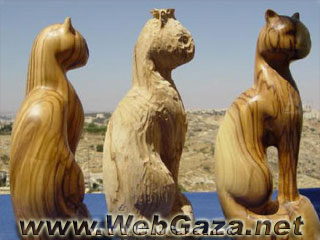 Olivewood Carving - Olivewood is a local material found throughout Palestine, and the wood carving can be traced back to the 16th and 17th centuries.