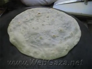 Saj Bread - It is a flat round bread baked on an upside down iron wok hot surface.